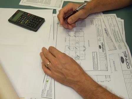 Engineer checking drawings for ahouse