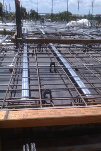 Post tensioned slab with tensioning ducts