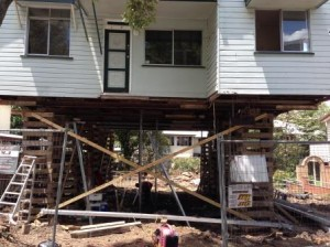 Photo of house being raised