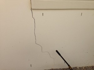 a photo of a large crack in a wall