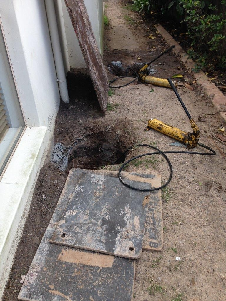 Photo of the hydraulic jacks used to raise a house that has been underpinned