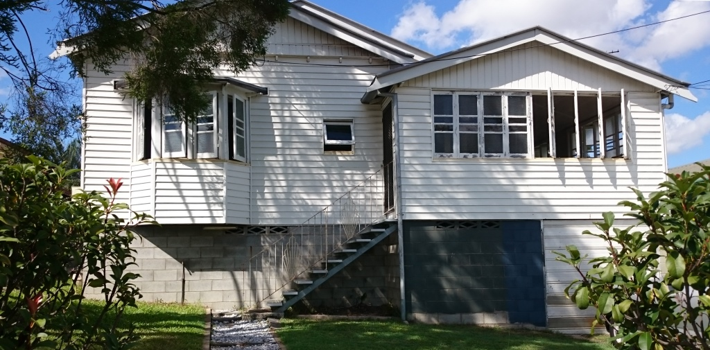 Photo of front of house that will soon be renovated
