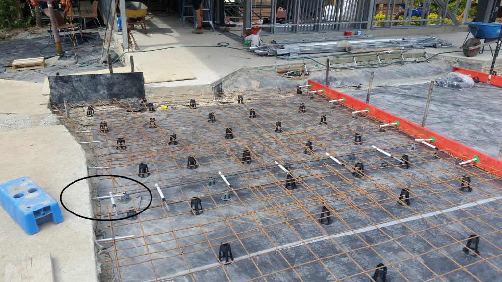 Dowels placed in two directions at the intersection of two control joints will cause this industrial concrete slab to crack.