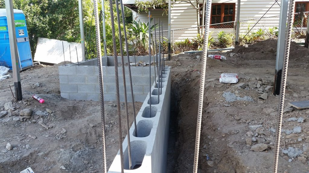 BEsser block wall retaining wall for house raise project
